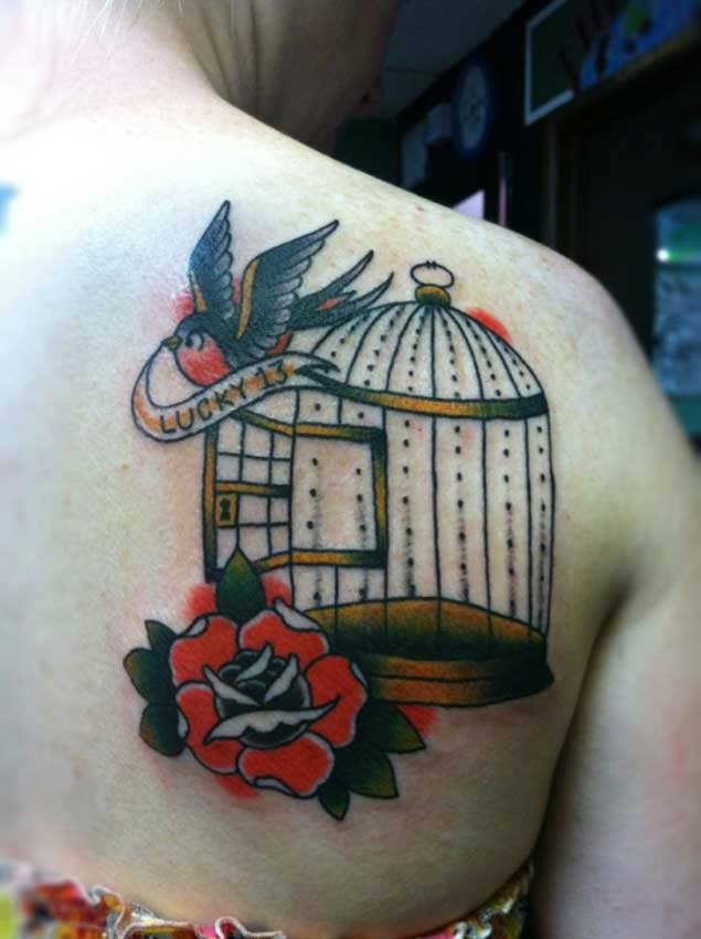bird cage tattoo with flower on back shoulder for women