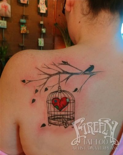 bird on tree branch heart in birdcage tattoo