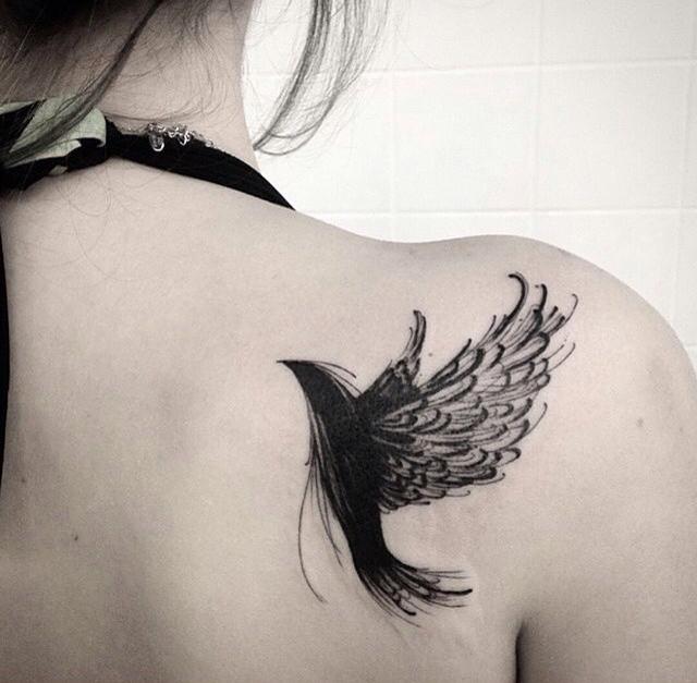 black colored bird sketch tattoo design on shoulder blade for women