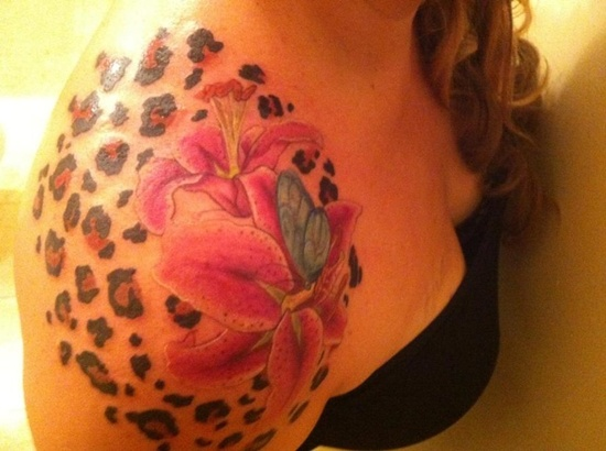 elegant tiger lily flower tattoo with tiger prints on right shoulder