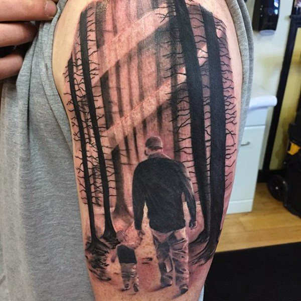 father son family tattoo walking in forest