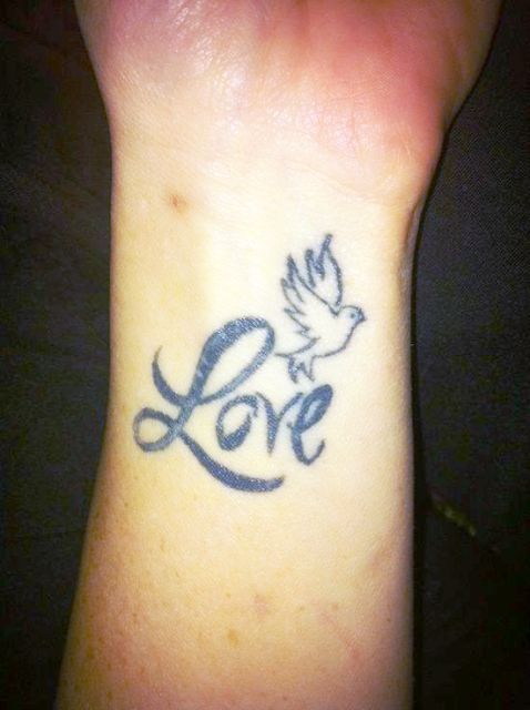 love dove tattoo on wrist