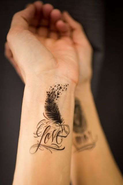 love feather flying hearts tattoo on wrist