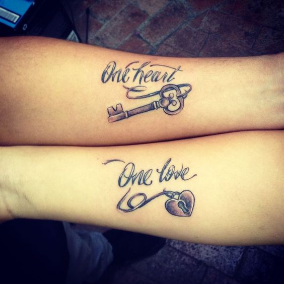 one heart one love tattoo on wrists
