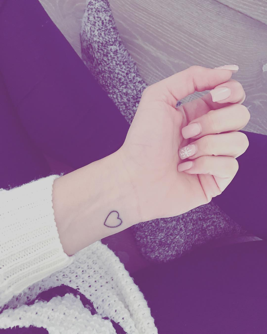outlined heart tattoo on wrist