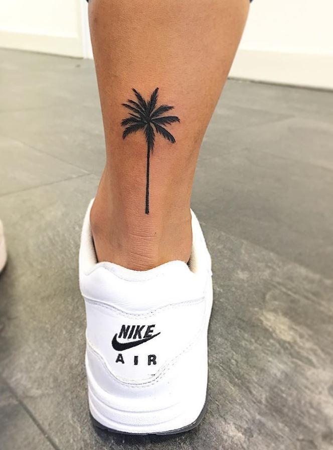 palm tree tattoo on back ankle