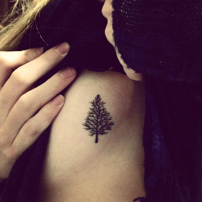small christmas tree tattoo on rib cage