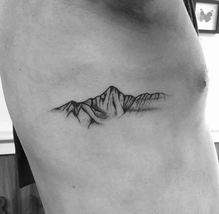 small rib cage mountains tattoo design