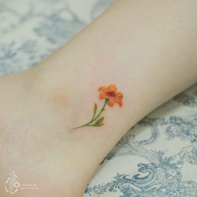 tiny tiger lily flower tattoo on ankle for women