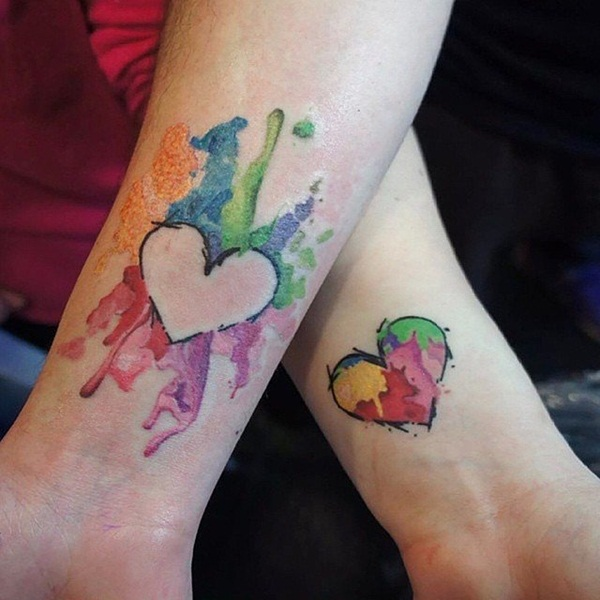 watercolor ink heart tattoo on wrists