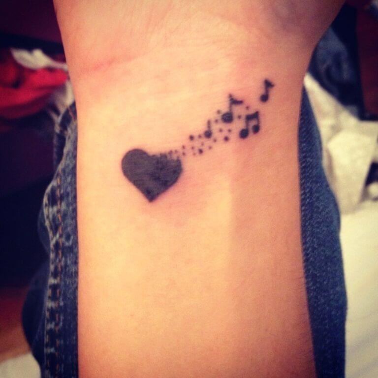 black music heart tattoo design on wrist