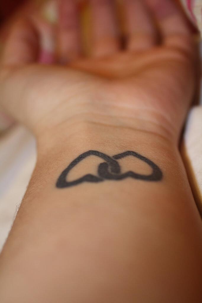 hearts chain tattoo on wrist