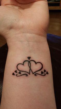 hearts tattoo on wrist