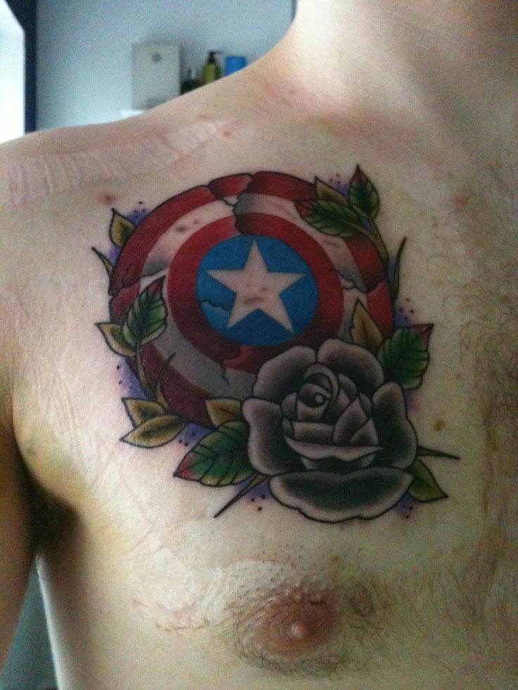 captain america shield tattoo on chest with rose flower and leaves