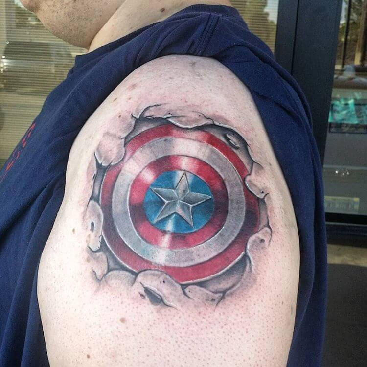 captain america shield tattoo on shoulder