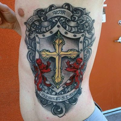 family crest shield cross tattoo on ribs cage