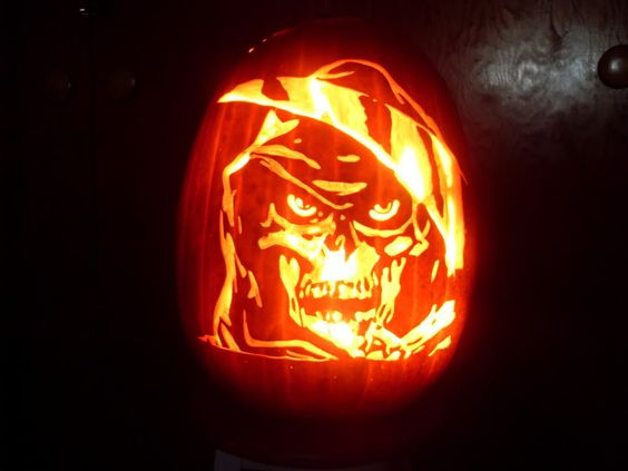 scary grim reaper carving pumpkin designs for halloween