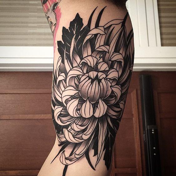 Chrysanthemum tattoo on bicep for men