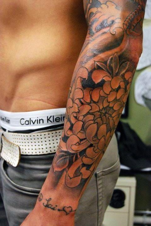 Chrysanthemum tattoo on full sleeve for men