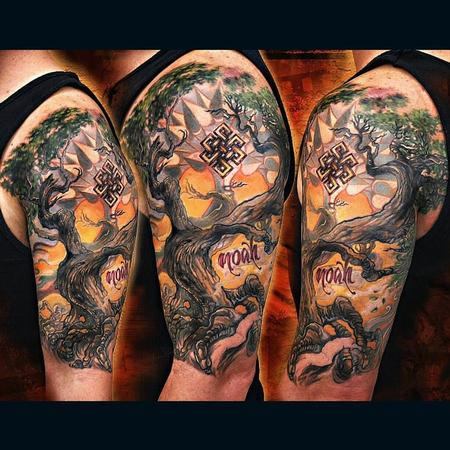 artistic bodhi tree tattoo on men upper sleeve