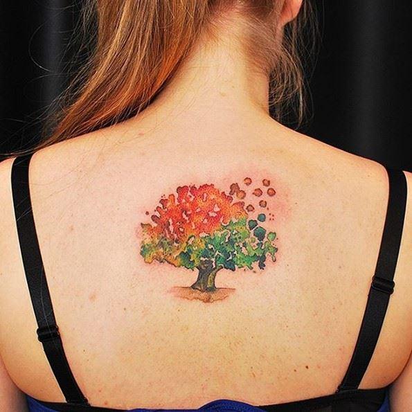 beautiful watercolor bodhi tree tattoo on girl back