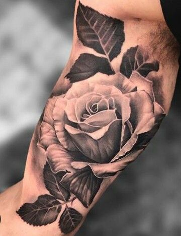 black and white rose flower tattoo on bicep for men