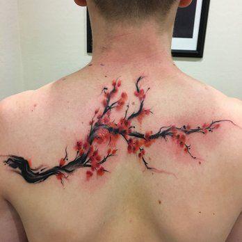 cherry blossom tree branch tattoo on back for men
