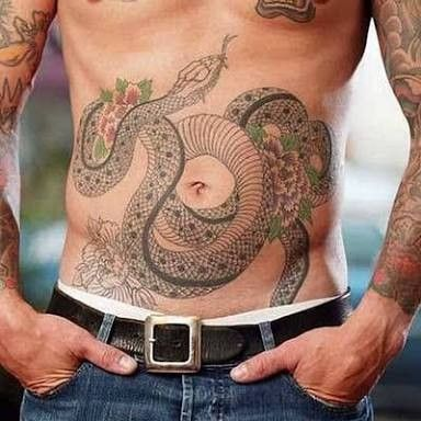 traditional japanese snake and carnation flower tattoo for men