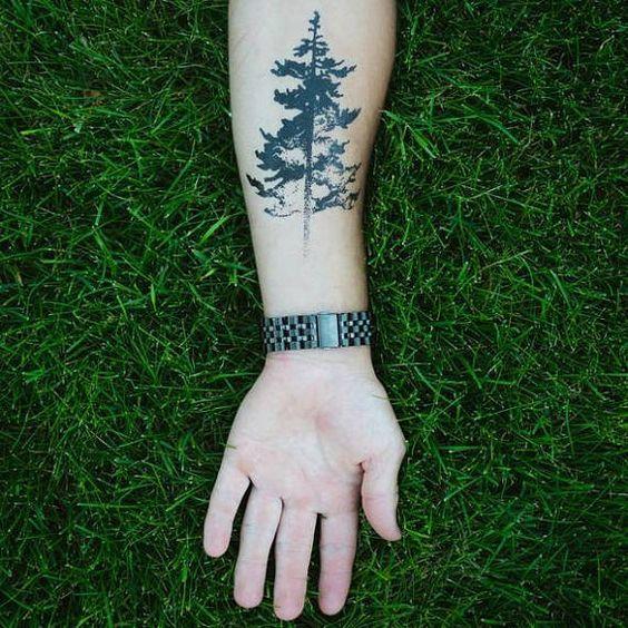 silhouette evergreen tattoo design on forearm