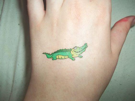 small green alligator tattoo design on hand