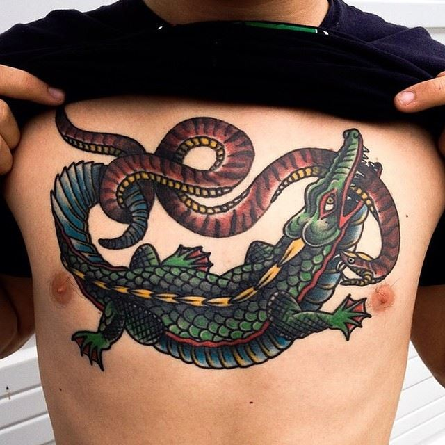 snake fighting crocodile tattoo design on chest