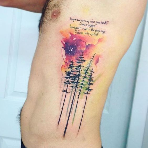 watercolor pine trees tattoo on side ribs for men