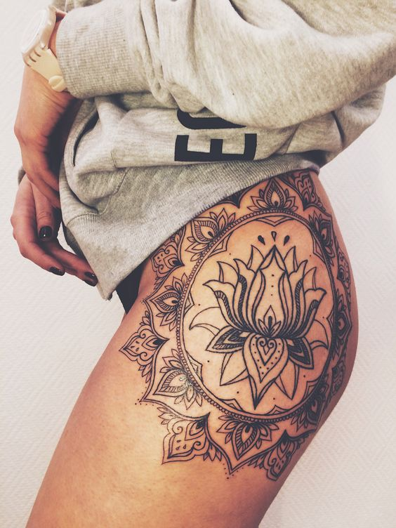 side thigh lotus flower tattoo