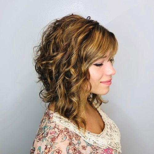 thick curly layered haircut for medium hair
