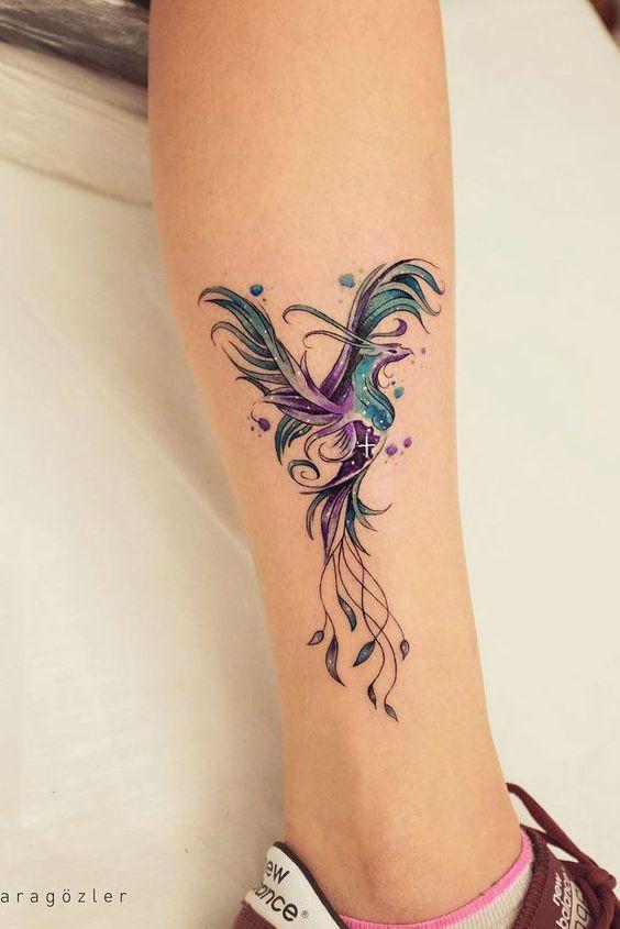 pretty phoenix tattoo on leg
