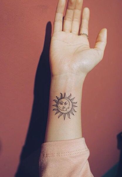 sun and moon tattoo design on wrist