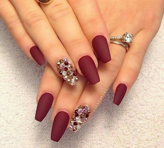 maroon nail art with diamonds on one finger