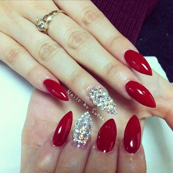 red Christmas stiletto nails with diamonds on single finger