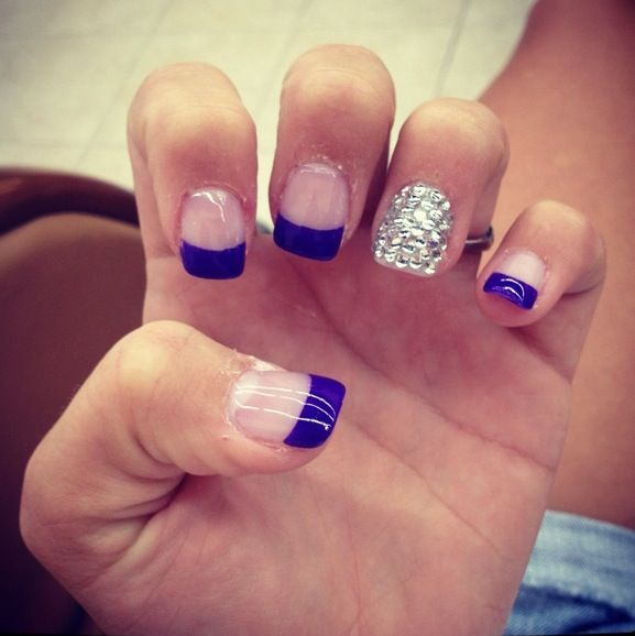 royal blue french tip nails with diamonds on one finger