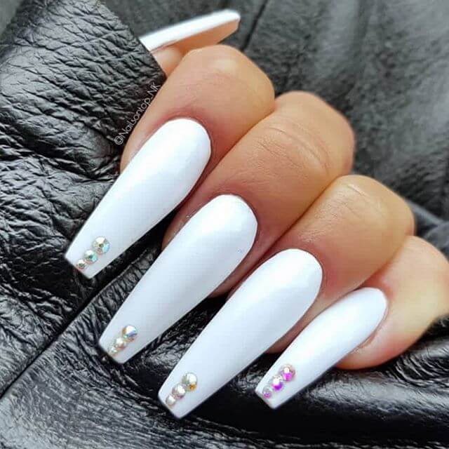 white acrylic coffin nails with rhinestones