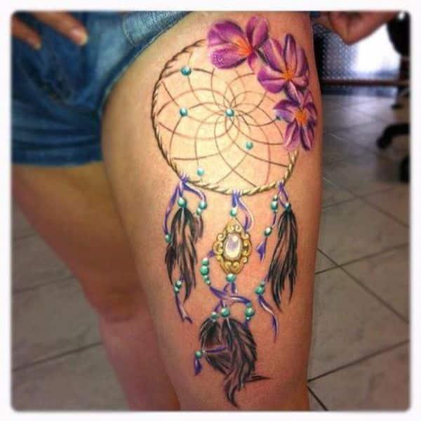 dreamcatcher with plumeria flower tattoo design on thigh