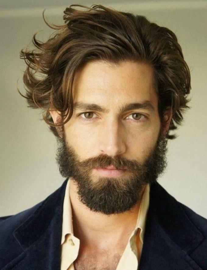 medium-length wavy hairstyle for men