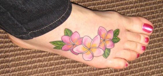 pink plumeria hawaiian flowers tattoo design on foot
