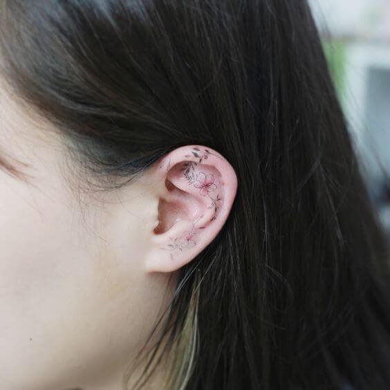 plumeria flower tattoo on ear