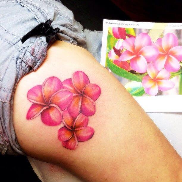 plumeria flower tattoo on side thigh