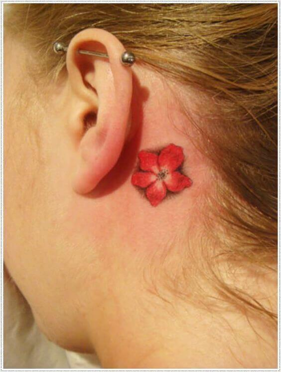 small plumeria flower tattoo behind ear