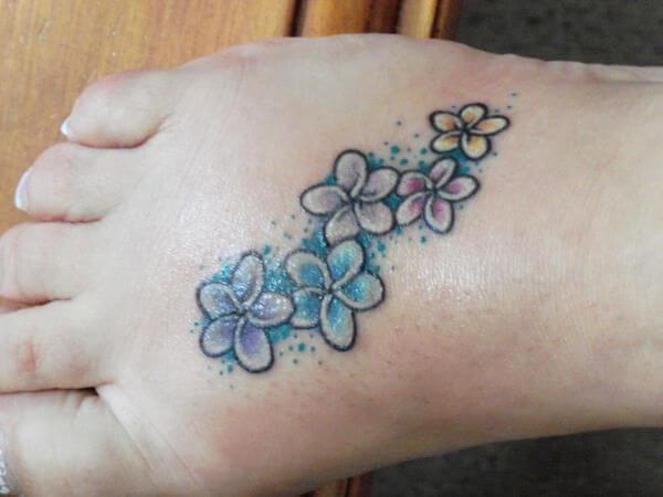 small plumeria flowers tattoo design on foot