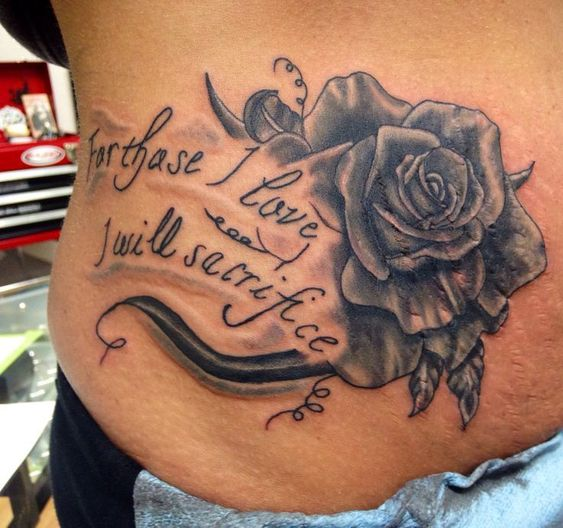 black ink rose flower with quote tattoo to cover stretch marks