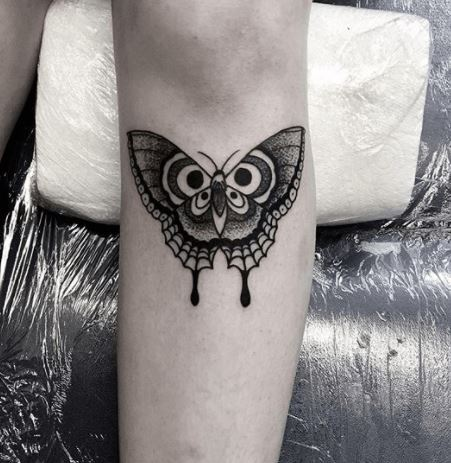 butterfly tattoo under knee
