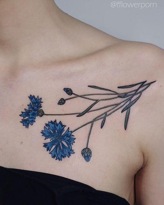 conflower tattoo design on collarbone